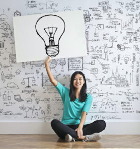 woman holding a light bulb drawing